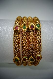 Picture of Peaceful maroon & green bangles with stone work
